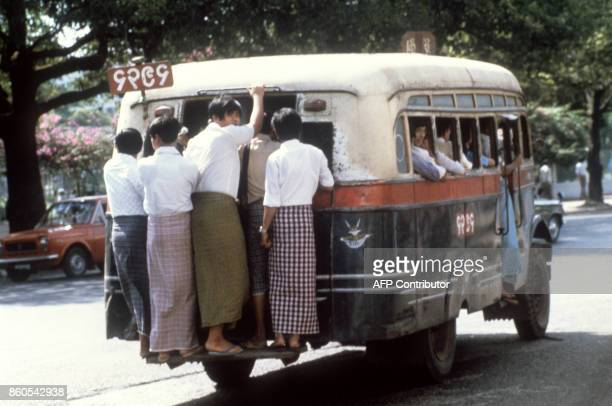 Picture taken in 1983 shows Burmese people in the streets of Rangoon / AFP PHOTO /
