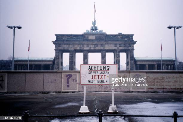 Picture taken in 1988 and made available on November 9, 2019 shows a view taken from West Berlin towards East Berlin, the Wall and the Brandenburg...