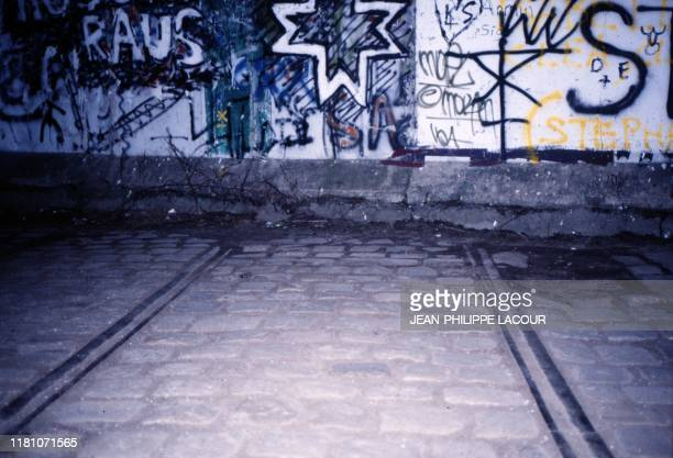 Picture taken in 1988 and made available on November 9, 2019 shows a view taken from West Berlin showing former traim rails ending at the Berlin...