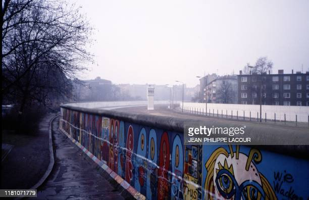 Picture taken in 1988 and made available on November 9, 2019 shows a view taken from West Berlin showing a watchtower on the death strip at the...