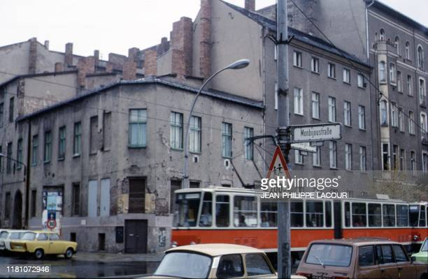 Picture taken in 1988 and made available on November 9 2019 shows a tram driving at Monbijoustrasse street near Hackescher Markt in Berlin's Mitte...