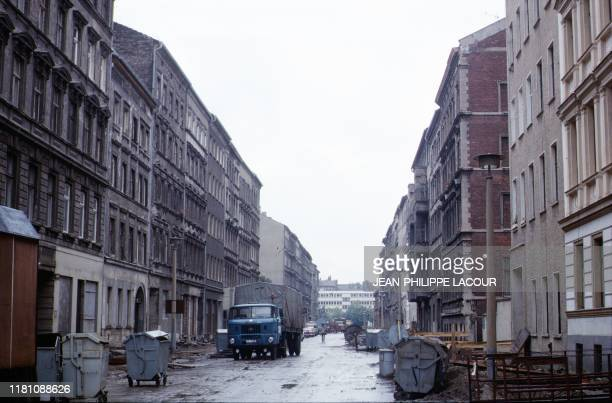 Picture taken in 1988 and made available on November 9 2019 shows a street scene in Berlin's Mitte or Prenzlauer Berg district in then East Berlin...