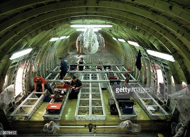 Picture taken in 2004 in Dresden shows the EADS Airbus' technicians working on installation of new floor structure The FrenchGerman consortium EADS...