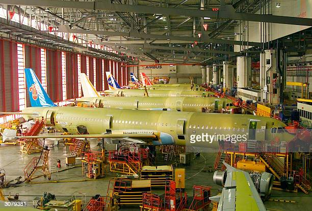Picture taken in 2004 in Hamburg shows the EADSmade Airbus A318 A319 and A321 airliners' finalassembly hall The FrenchGerman consortium EADS who is...