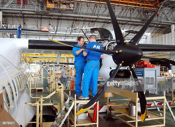 Picture taken in 2004 in Toulouse shows the EADS ATR technicians working on an ATR airliner The FrenchGerman consortium EADS who is the secondbiggest...