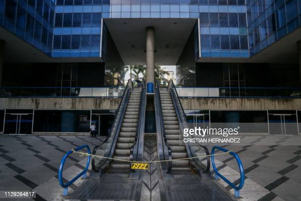 Picture taken in a closed mall in Caracas on March 8 2019 during the worst power outage in Venezuela's history Venezuela was plunged into darkness on...