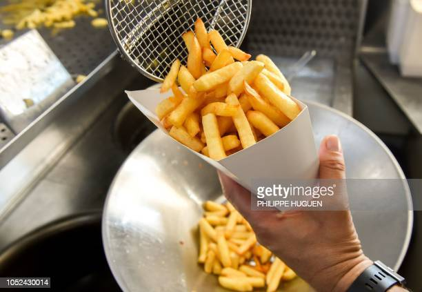 A picture taken in a food truck in Steenvoorde northern France on October 15 2018 shows French fries as the harvest of potatoes reduced following...