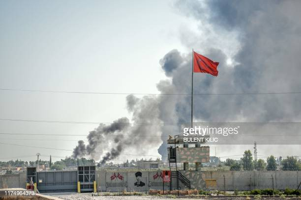TOPSHOT A picture taken in Akcakale at the Turkish border with Syria on October 10 2019 shows smokes rising from the Syrian town of Tal Abyad after a...