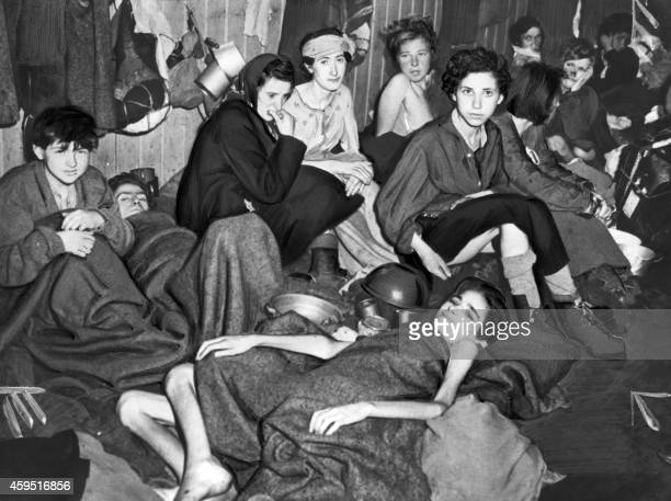 A picture taken in April 1945 in Nazi Bergen Belsen death camp after its liberation by the British troops shows female deportees suffering from...