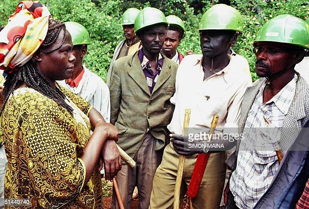 A picture taken in April 1999 shows Kenya's Wangari Maathai challenging hired security people in the Karura Forest in the Kenyan Capital Nairobi...