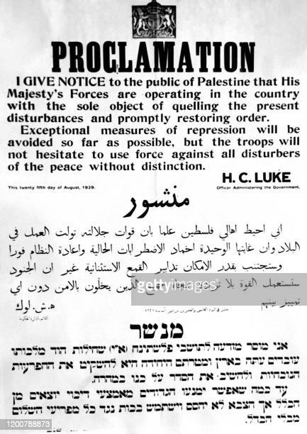 Picture taken in August 1929 during the British mandate in Palestine shows a warning proclamation by the British authority as violent clashes occur...