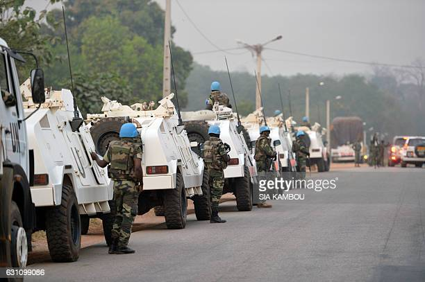 A picture taken in Bouake on January 6 2017 shows an UN Blue Helmet peacekeepers convoy parked at the entrance of the city where soldiers demanding...