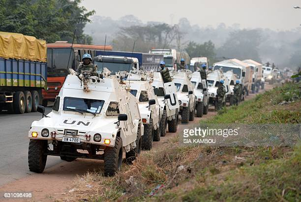 Picture taken in Bouake on January 6, 2017 shows UN Blue Helmet peacekeepers vehicles in line at the entrance of the city where soldiers demanding...
