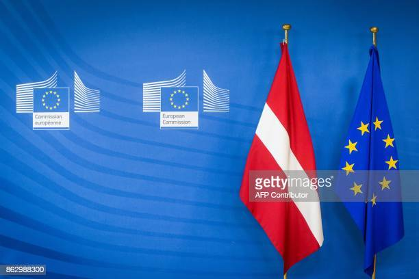 A picture taken in Brussels on October 19 2017 on the first day of a summit of European Union leaders shows Latvian and European Union flags / AFP...