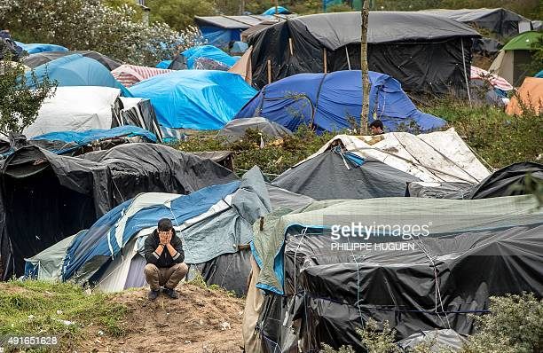 A picture taken in Calais on October 7 2015 shows a site dubbed the 'New Jungle' where some 3000 people have set up camp most seeking desperately to...