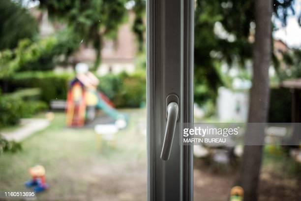 A picture taken in Chatillon south of Paris on August 7 2019 shows a view on the garden at the centre d'hebergement et de reinsertion sociale a...