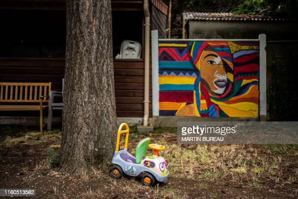 TOPSHOT A picture taken in Chatillon south of Paris on August 7 2019 shows children toys in the garden of the centre d'hebergement et de reinsertion...
