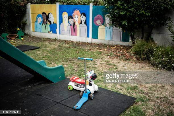 A picture taken in Chatillon south of Paris on August 7 2019 shows toys for children in the garden of the centre d'hebergement et de reinsertion...