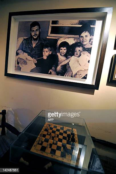A picture taken in Cuba of Ernesto Che Guevara with his wife Hilda Gadea and their four children is displayed in the Ernesto Che Guevara Museum at...