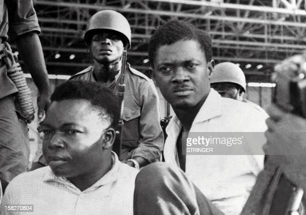 Picture taken in December 1960, shows soldiers guarding Patrice Lumumba , Prime Minister of then Congo-Kinshasa, and Joseph Okito , vice-president of...