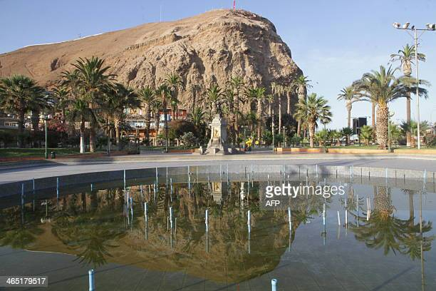 Picture taken in downtown Arica in Chile close to the border with Peru and about 2100 km north of Santiago on January 262014 Both Peruvians and...