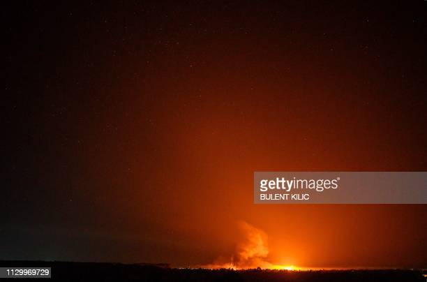 Picture taken in eastern Syrian province of Deir Ezzor shows explosions following shelling by the US-backed forces on the Islamic State group's...