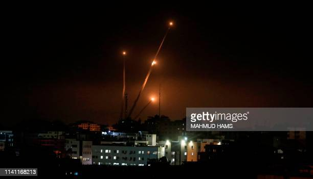 Picture taken in Gaza city on May 5, 2019 shows rockets fired toward the Israeli areas from Gaza Strip. - Gaza militants on Saturday fired some 250...