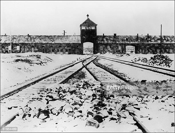 A picture taken in January 1945 depicts Auschwitz concentration camp gate and railways after its liberation by Soviet troops // Photo prise en...