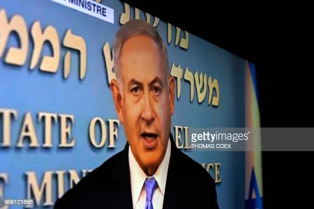 A picture taken in Jerusalem of a TV screen shows Israeli Prime Minister Benjamin Netanyahu delivering a televised speech on Israeli TV after the US...