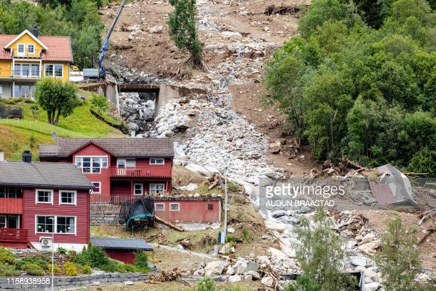 A picture taken in Joelster conty on August 1 2019 shows damages near houses two days after mudslides / Norway OUT