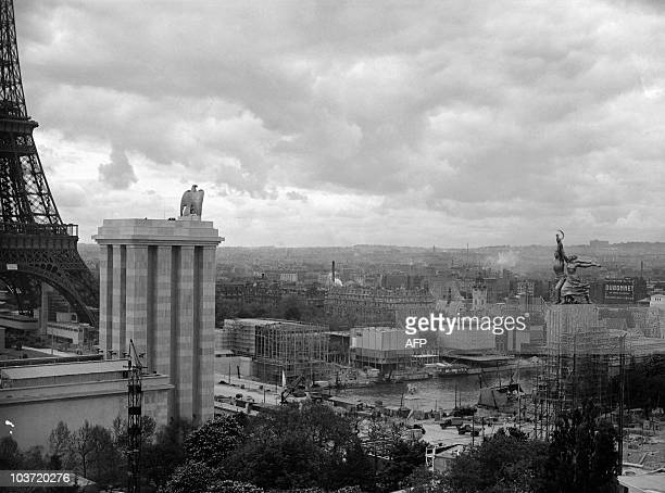A picture taken in June 1937 shows a general view of the Paris 1937 World Fair with the pavilion of the USSR topped by Soviet sculptress Vera...