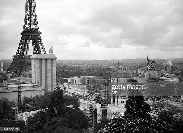 A picture taken in June 1937 shows a general view of the Paris 1937 World Fair still being constructed with the pavilion of the USSR topped by Soviet...