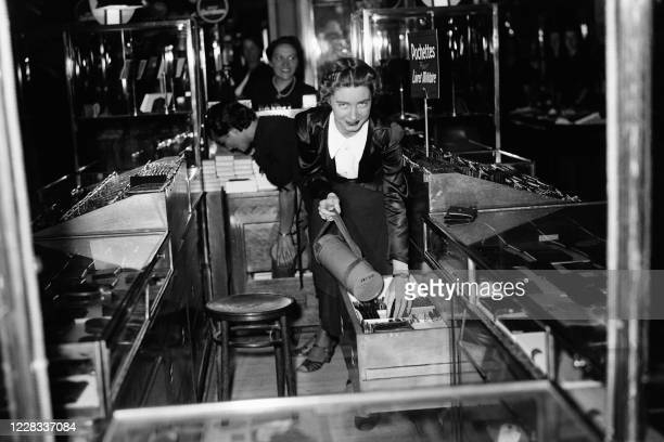Picture taken in June 1940 at Paris showing employees of a departement store during the setting up of passive defence measures due to the lead of the...