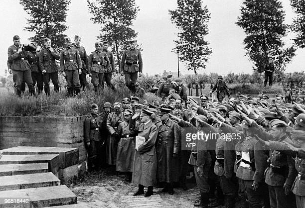 A picture taken in June 1940 during World War II at Langemark German cemetery nazi Chancellor Adolf Hitler pays tribute to German soldiers fallen...