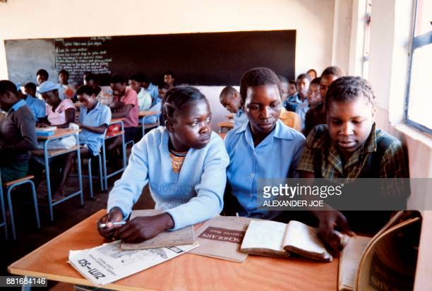Picture taken in June 1984 of Zimbabwean students writing in a classroom of their primary school of Mtoko North East of Zimbabawe / AFP PHOTO /...