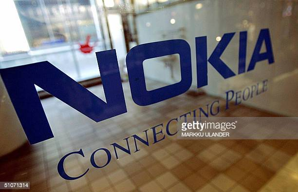 A picture taken in June 2004 shows the Nokia logo on the door of the empty premises in Helsinki European stock markets skidded lower 15 July 2004...