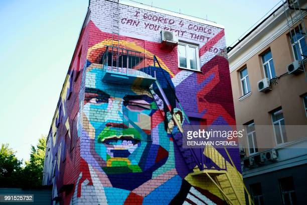 TOPSHOT A picture taken in Kazan on July 4 2018 shows a mural depicting Portugals' forward Cristiano Ronaldo / RESTRICTED TO EDITORIAL USE MANDATORY...