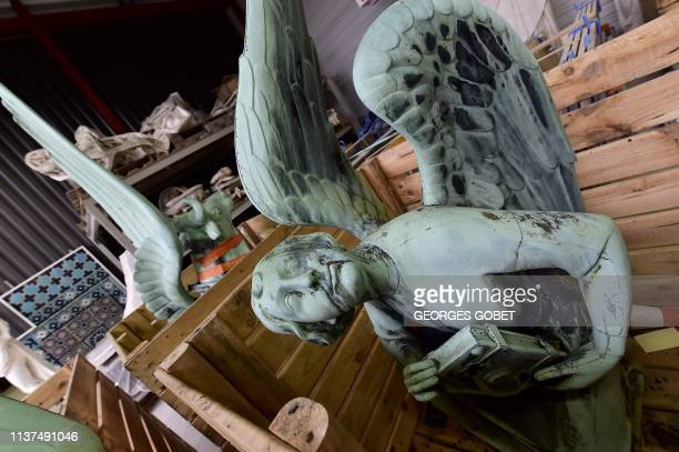 Picture taken in Marsac-sur-Isle near Bordeaux, on April 16, 2019 shows a statue which sat at the bottom the spire of the Notre-Dame cathedral in...