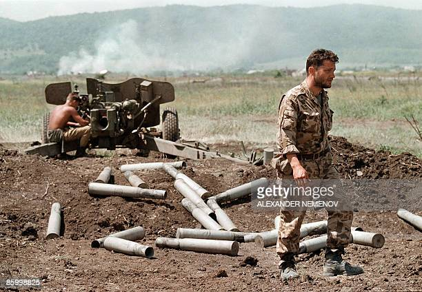 Picture taken in May 1996 shows Russian soldiers shelling the Chechen village of Bamut Russia on April 16 2009 ended an antiterror operation in...