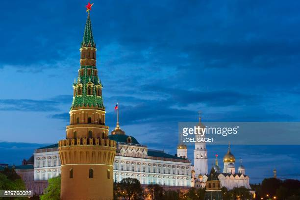 A picture taken in Moscow on May 6 2016 shows the Vodovzvodnaya Tower the Great Kremlin Palace and The Ivan the Great Bell Tower the tallest tower of...