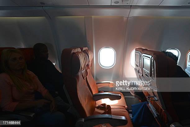 A picture taken in Moscow Sheremetyevo airport aboard a plane of Aeroflot flight from Moscow to Havana on June 24 shows the empty window seat 17A...