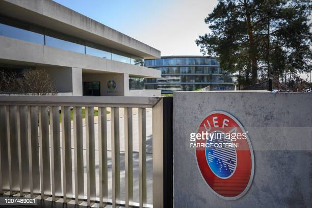 A picture taken in Nyon on March 17 2020 shows the gate at the headquarters of UEFA the European football's governing body amid spread of novel...