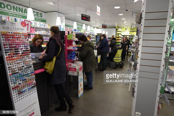 A picture taken in Orleans on January 11 2018 shows custumers in a pharmacy France said on January 11 there has been a 'major dysfunction' in a...