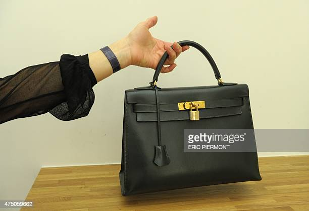 Picture taken in Paris on April 30, 2015 shows a second-hand luxury bag presented at Collector Square showroom. Collector Square is a website and a...