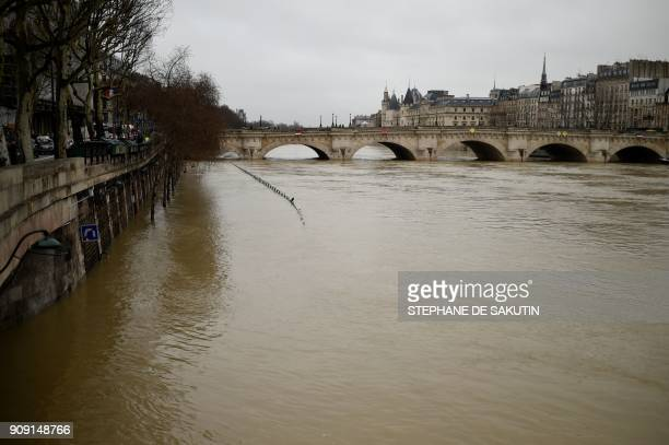 A picture taken in Paris on January 23 2018 shows the Pont Neuf as the river Seine level has risen following torrential rain The Seine burst its...