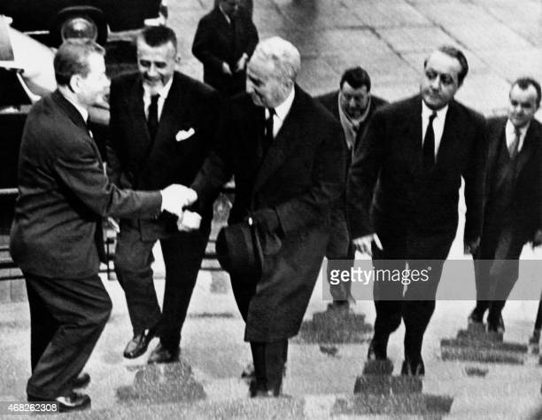 A picture taken in Paris on March 10 1962 shows French negociators for the 'Accords d'Evian' Robert Buron Louis Joxe and Jean de Broglie welcomed by...