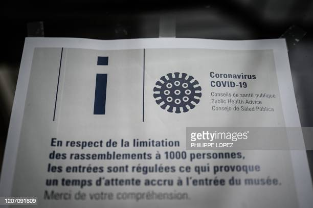 A picture taken in Paris on March 14 shows an informative sign on the door of the Orsay Museum closed amid the outbreak of COVID19 the new...
