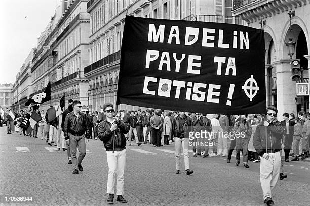 A picture taken in Paris on May 11 1986 shows activists of French youth farright groups GUD and Jeune Garde displaying a banner asking Alain Madelin...