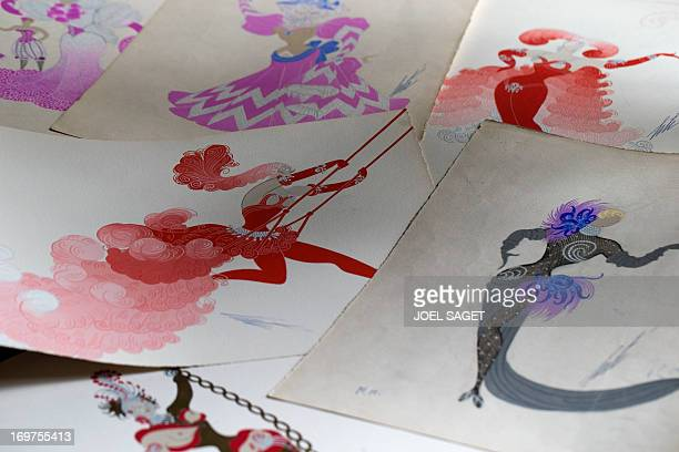 A picture taken in Paris on May 31 shows various drawings by FrancoRussian artist Romain de Tirtoff also known as 'Erte' Over 300 drawings by artist...