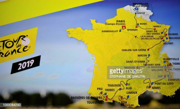 TOPSHOT A picture taken in Paris on October 25 2018 during the presentation of the 2019 edition of the Tour de France cycling race shows the map of...